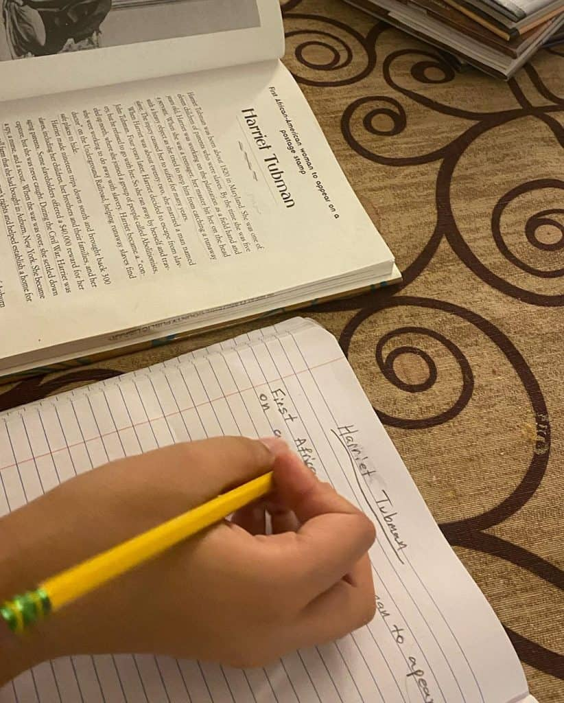 Muslim homeschooled middle school children work on writing composition.