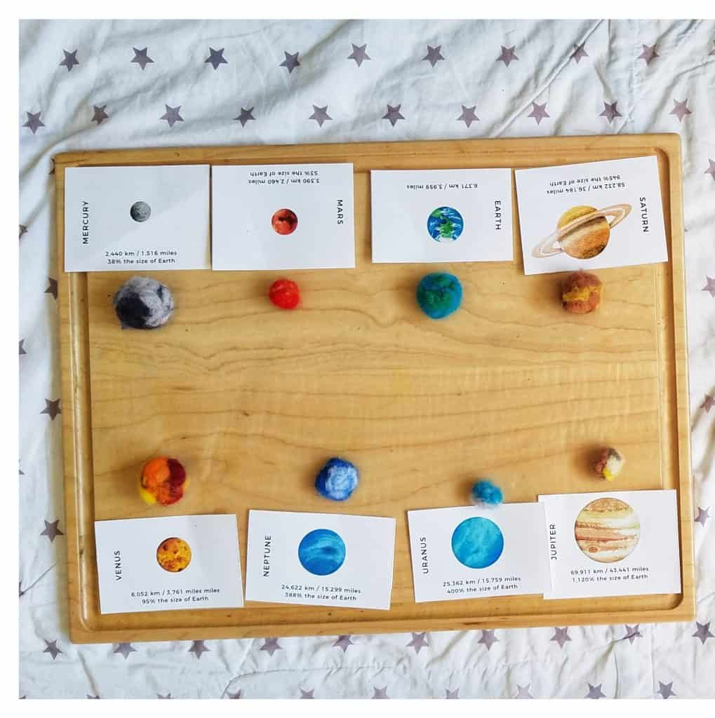 Needle felted planets are a great handicraft for learning about the solar system in your Muslim homeschool.
